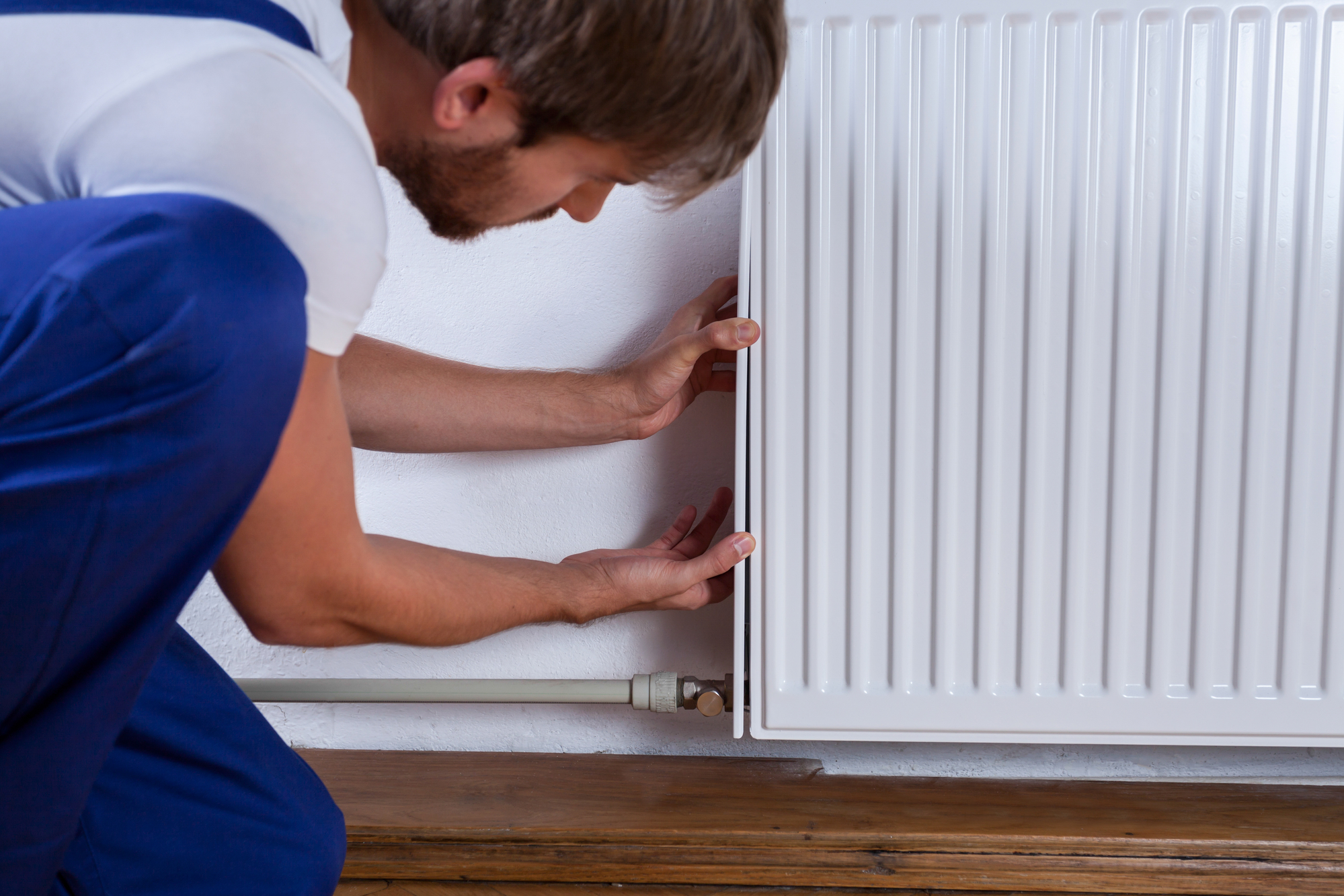 Technician Fixing a Steam Heat Radiator