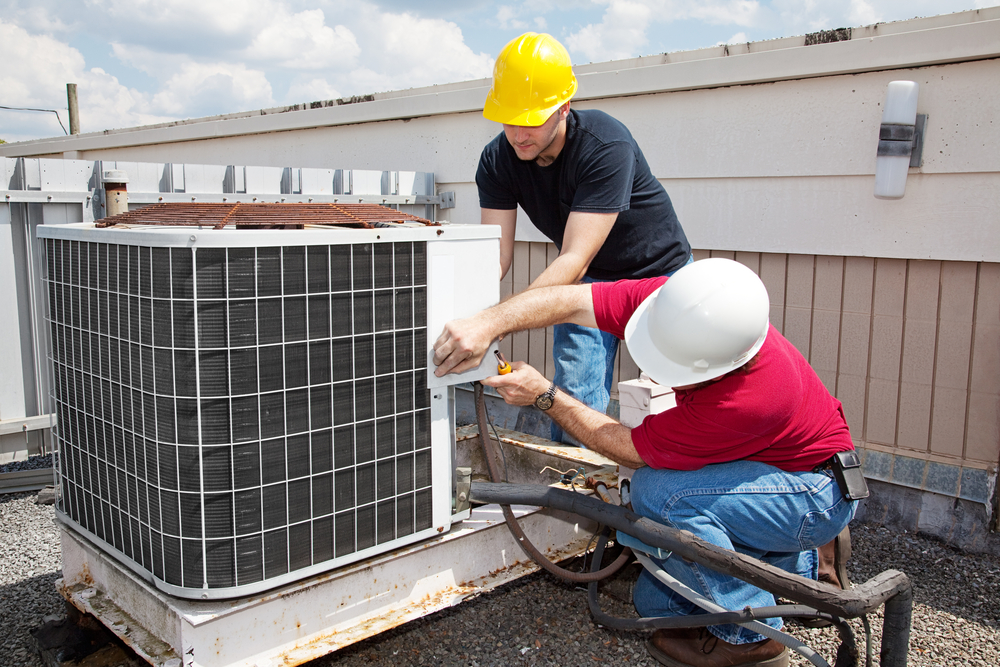 HVAC Company Technicians Fixing an Air Conditioner